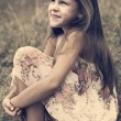 Little girl a park near the river — Stock Photo