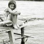 Little girl a park near the river — Stock Photo