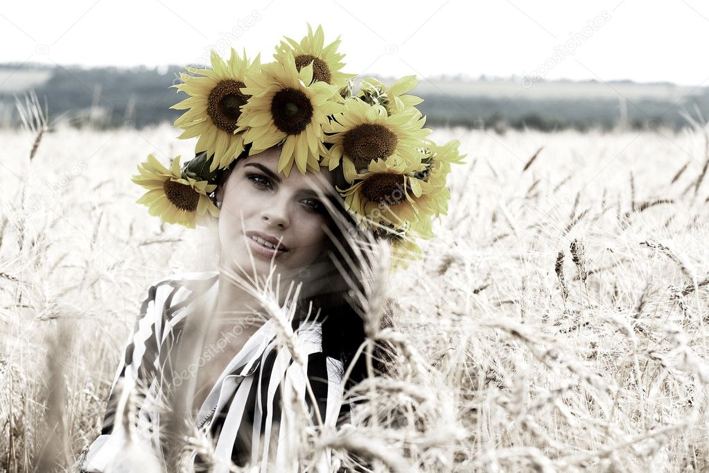 A beautiful  girl is in the field  Stock Photo #6483491