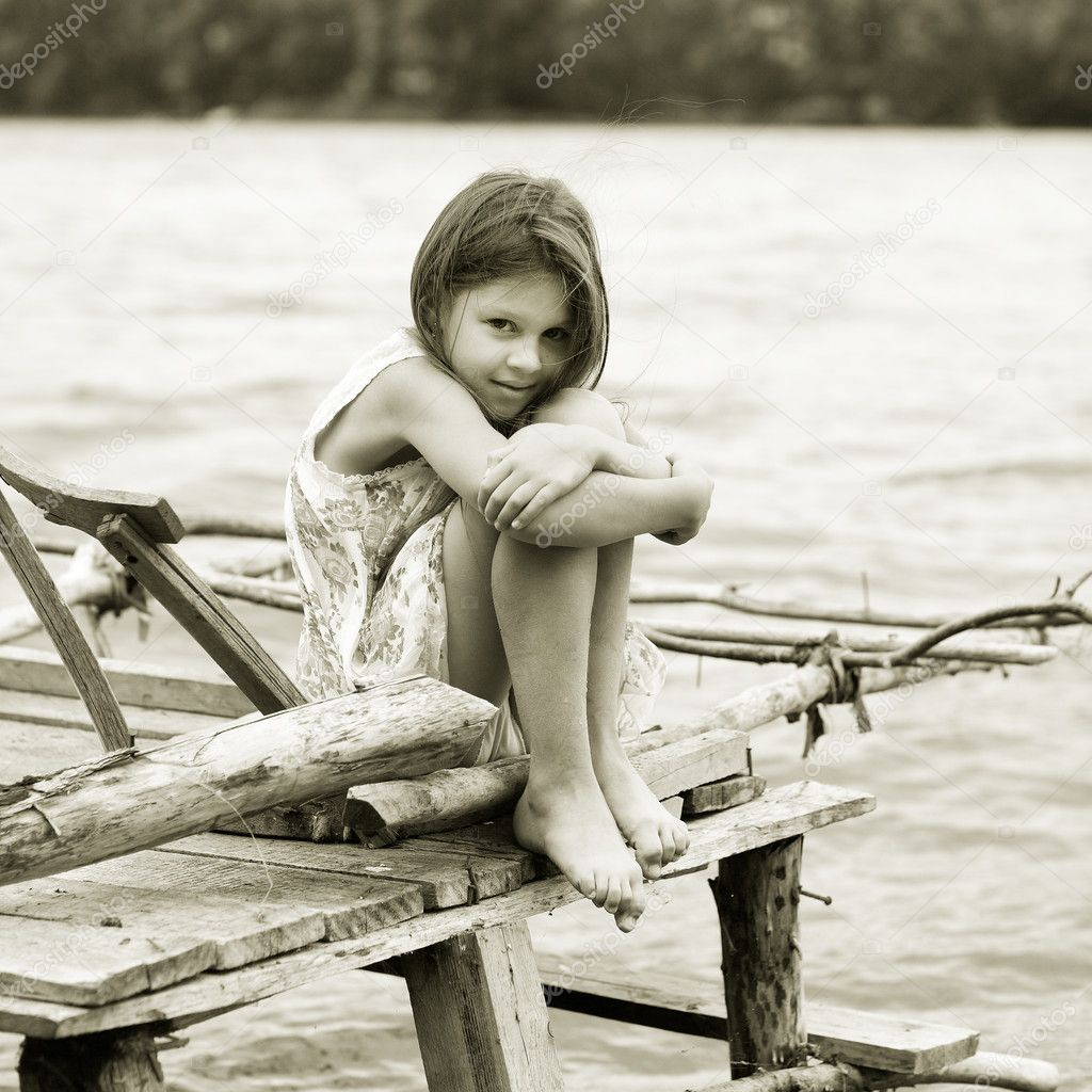Little girl a park near the river — Stock Photo #6484888