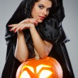 Sexual brunette in the suit of witch in night of Halloween — Stock Photo #6572160