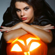 Sexual brunette in the suit of witch in night of Halloween — Stock Photo #6572171