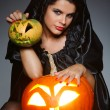 Sexual brunette in the suit of witch in night of Halloween — Stock Photo #6572172