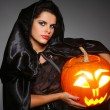 Sexual brunette in the suit of witch in night of Halloween — Stock Photo #6572173