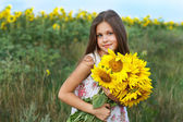 A little girl is in the field — Stock Photo