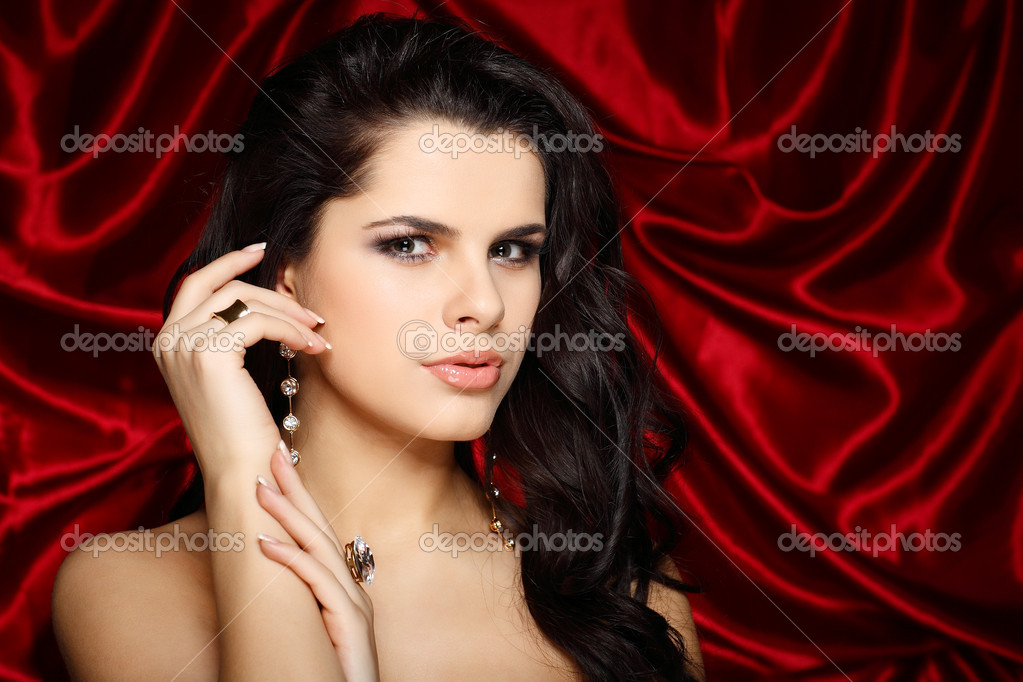 A beautiful young woman is in red clothes  Stock Photo #6681951
