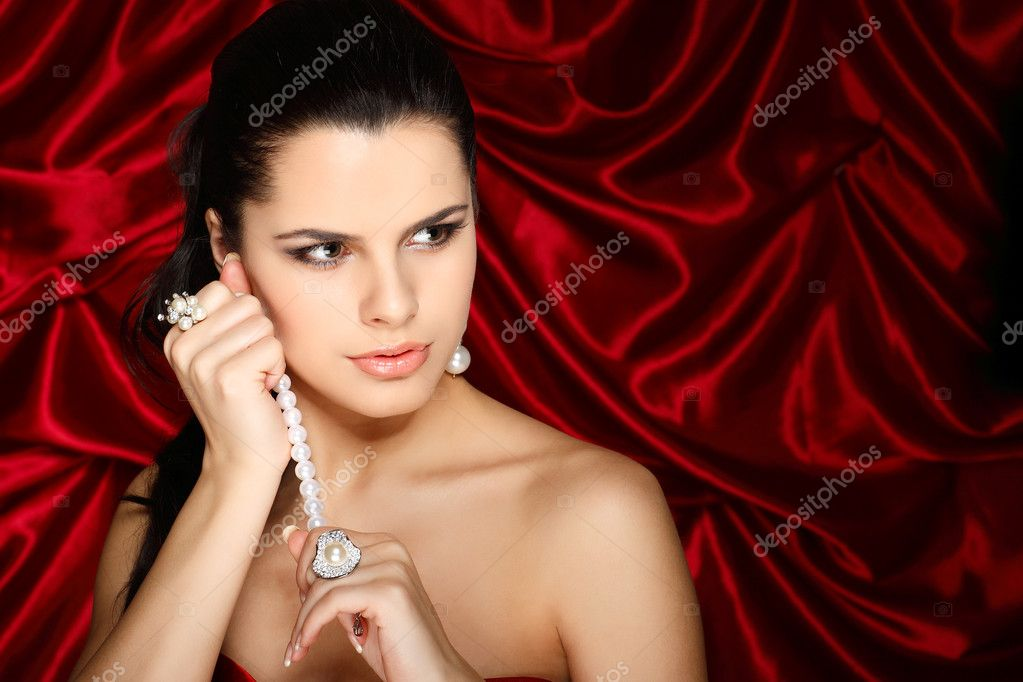A beautiful young woman is in red clothes  Stock Photo #6681964