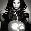 Sexual brunette in the suit of witch in night of Halloween - ストック写真