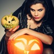 Sexual brunette in the suit of witch in night of Halloween — Stock Photo #6695894