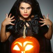 Sexual brunette in the suit of witch in night of Halloween — Stock Photo #6695895