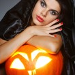 Sexual brunette in the suit of witch in night of Halloween — Stock Photo #6695898