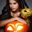 Sexual brunette in the suit of witch in night of Halloween — Stock Photo #6695900
