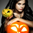 Sexual brunette in the suit of witch in night of Halloween — Stock Photo #6695902
