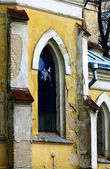 A fragment of a wall and a window of the old Lutheran church — Stock Photo