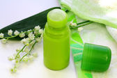 Lily of the valley, Turkish towel and a green deodorant — Stock Photo