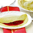Appetizing pancakes with a red currant — Stock Photo