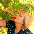Beautiful woman is eating ashberry — Stock Photo