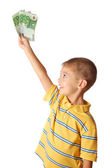 Happy child holds money in hand isolated on white background — Stock Photo