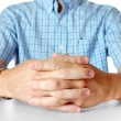 Mens hands sitting opposite at table — Stock Photo #6004196