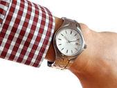 Wrist watch on hand isolated on white background — Stock Photo