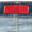 Red label inside blue jeans — Stock Photo