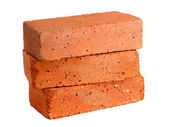 Stack of old red bricks isolated on white background — Stock Photo