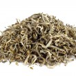 Pile of air-dried green chinese tea isolated on white background — Stock Photo