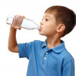 Child drinks water from bottle isolated on white background — Stock Photo #6159850