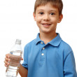 Happy child holds bottle of water isolated on white background — Stock Photo