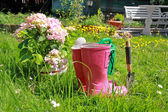 Pink wellingtons in the Spring garden — Stock Photo