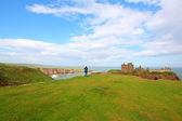 A tourist at Dunnottar Castle, Stonehaven, Scotland — Stock Photo