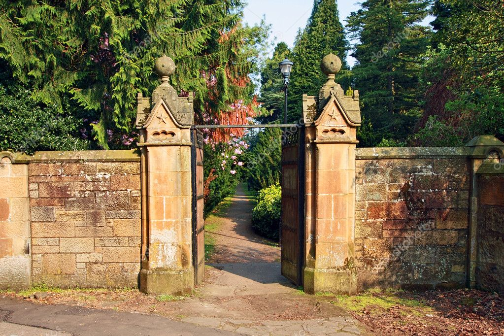 old stone gate leading to beautiful garden stock photo. Black Bedroom Furniture Sets. Home Design Ideas