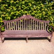 Old, English bench in the garden - Stock Photo