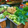 Stockfoto: Stalls with fresh vegetables and fruit at market square