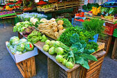 Stalls with fresh vegetables and fruit at market square — Stock Photo