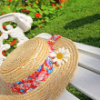 Peacuful summer garden with a hat — Stock Photo