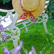 Peacuful summer garden with a hat — Stock Photo #6605393