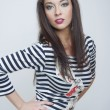 Beautiful fashion girl in stripes clothes - Stok fotoraf