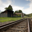 Railway in village romantic lanscape scene - Stock Photo