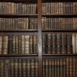 Old books in old library - Stock Photo
