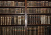 Old books in old library — Stock Photo