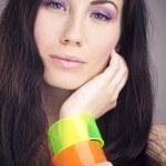 Beautiful girl with colorful bangle — Stock Photo #5521837