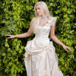 Blond bride in luxury clothes — Stock Photo