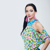 Beautiful fashion girl in colorful clothes — Stock Photo