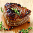 Stock Photo: Juicy sirloin beef with branches of thyme covered in pepper
