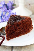 Chocolate delicious cake on white plate — Stock Photo