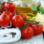 Pasta ingredient olive oil, tomato Italian Still Life — Stock Photo #5465559