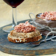 Stock Photo: Pate of duck meat Rillettes de Canard with glass of wine