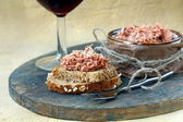 Pate of duck meat Rillettes de Canard with a glass of wine — Stock Photo