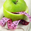 Royalty-Free Stock Photo: Apple and a measure tape, diet concept